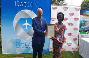 British High Commissioner Rowan Laxton presents Fadimatou Noutchemo Simo with the Points of Light Award