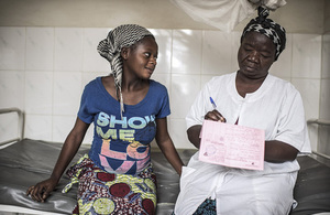 Picture showing woman receiving family planning advice and supplies.