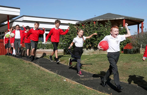 image showing Pupils trying out the new footpath created by road workers