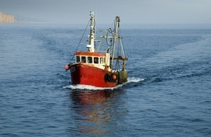 Fishing boat steaming into shore