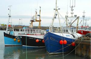 Three UK fishing vessels in a port