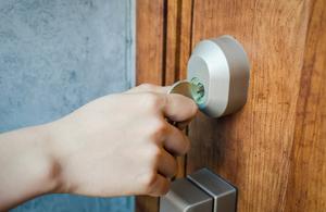 Image of person locking door