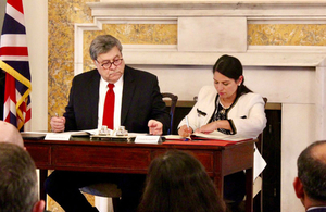 Home Secretary Priti Patel signing the UK-US Data Access Agreement