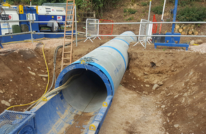 image showing a tunnelling machine breaking through underneath the A38