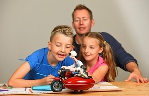 Children participating in drawing activity with a model of Wallace & Gromit riding a motorbike