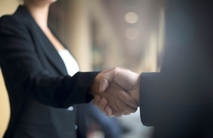 An image of two business people shaking hands