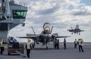 First F-35 fighter jet lands onboard HMS Queen Elizabeth.