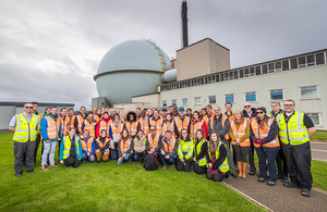 The international delegates are photographed in front of the Dounreay Fast Reactor, which is being decommissioned
