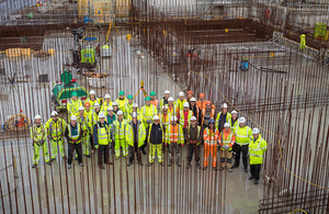 The team and members of senior management are pictured before work begins on the final concrete pour