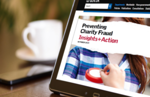 A computer screen displaying the front page of a research report about charity fraud.