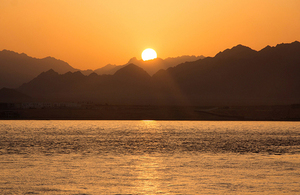Sun setting behind desert mountains at Sharm El Sheik