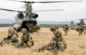 Royal Marines from 42 Commando emerge from RAF Chinook helicopters on the Barry Buddon training area in Scotland [Picture: Petty Officer (Photographer) Sean Clee, Crown copyright]