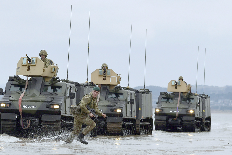 Royal Marines from 42 Commando launch a beach assault