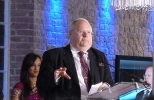 Eric Pickles at a podium