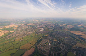 Aerial photograph of a town in the UK surrounded by countryside