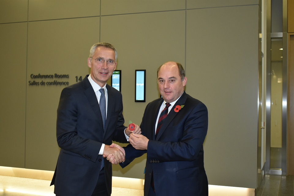 Defence Secretary Ben Wallace presents NATO Secretary General Jens Stoltenberg with a poppy