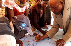 Beneficiaries of a cash transfer scheme on Kwakavisi community in Kenya undertaking a mapping exercise.