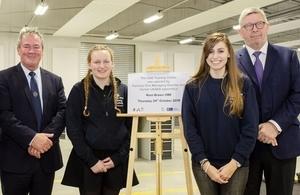 OAS Director David Martin, OAS engineering apprentices Rebecca Marsh and Ella Quigley, and FIA managing director Ross Brawn
