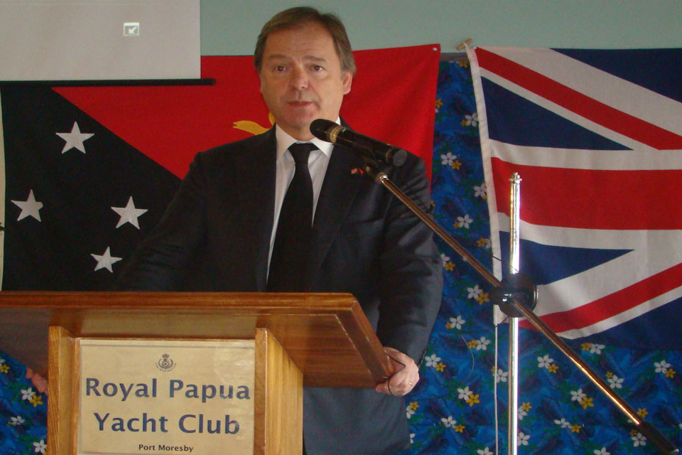 Minister of State Hugo Swire speaking at the Port Moresby Chamber of Commerce breakfast.