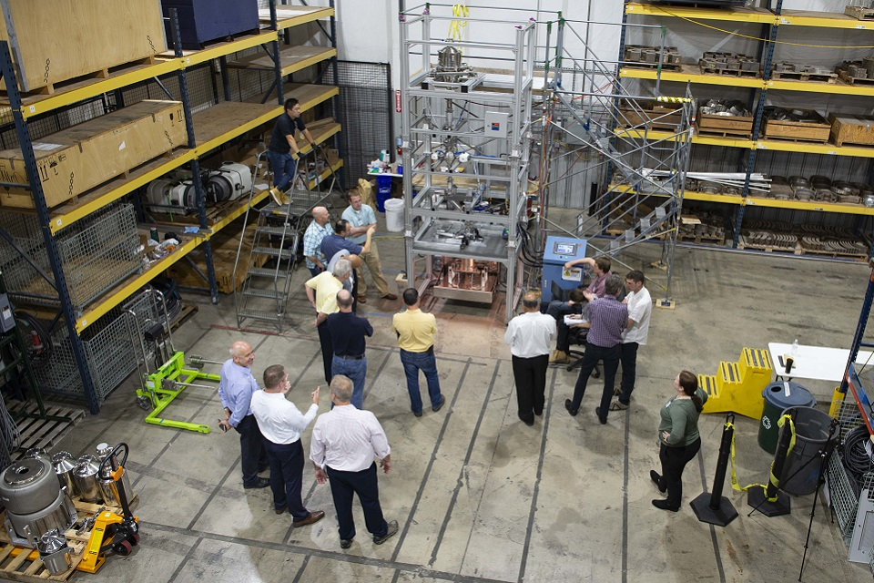 An overhead view of the HIP rig in America, with various observers standing around