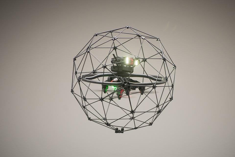An in-flight drone, shaped like a sphere