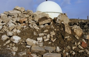 A pile of concrete rubble in front of Dounreay's Fast Reactor