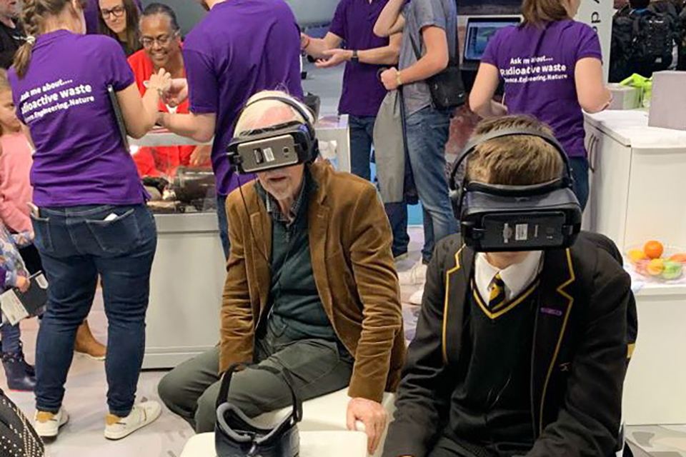 Different generations using VR equipment at RWM stand