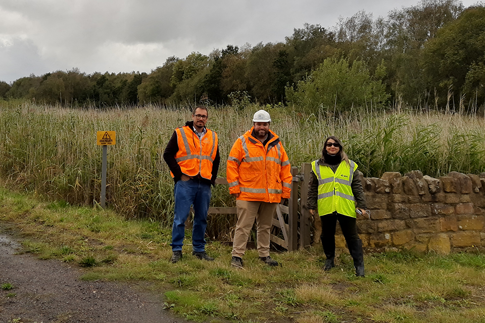 Chris Satterley, technical lead for our geochemistry, process chemistry and process engineering team, showing the visitors from Brazil around a reed bed.