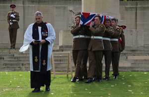 Reverend Paul Whitehead leads the soldiers from the 1st Battalion The Royal Anglian Regiment as they carry Lance Corporal Perkins to his final resting place