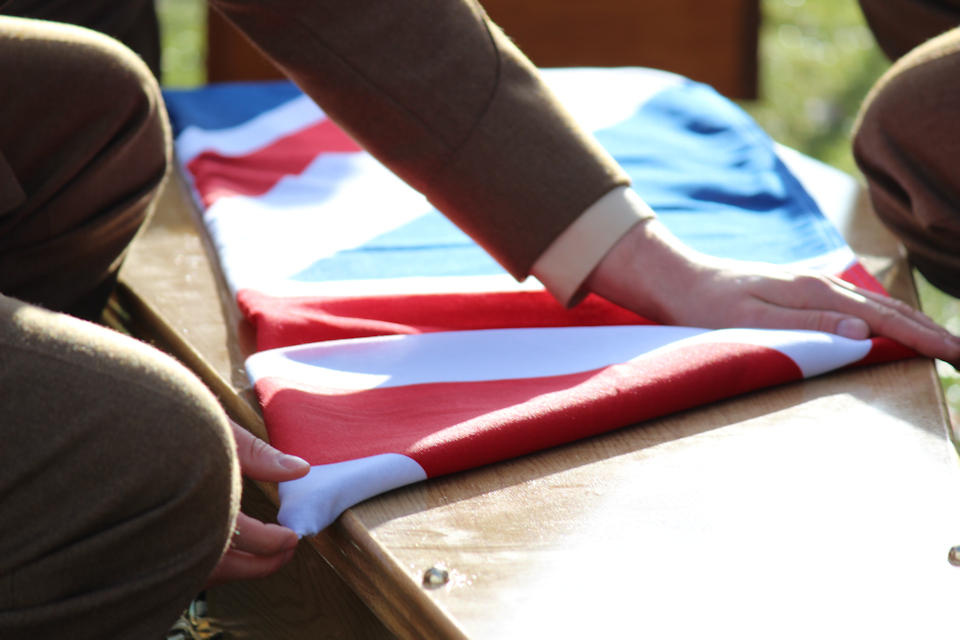Union Flag is folded as it lays upon the coffin