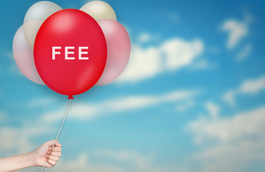 Images of a hand holding balloons and the central red balloon has the word 'Fee'