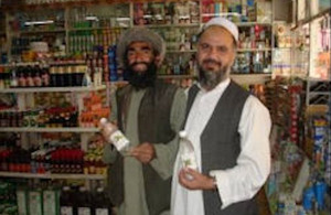 Farmer (left) supplying mint water to satisfied shopkeeper.