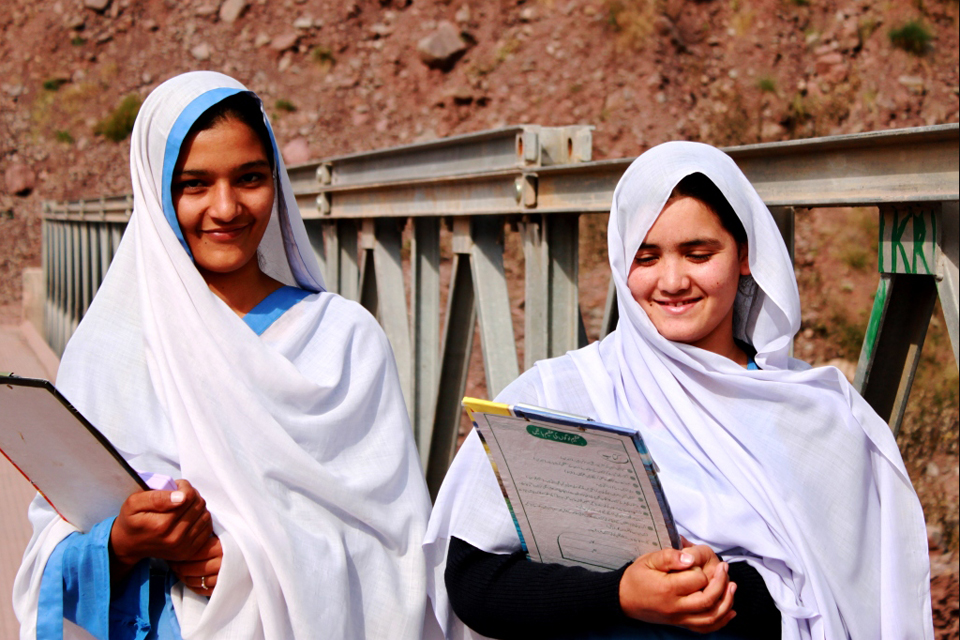 Students Andleed (left) and Nusrat (right) use a new bridge built with british support to get to school every day. Picture: Victoria Francis/DFID