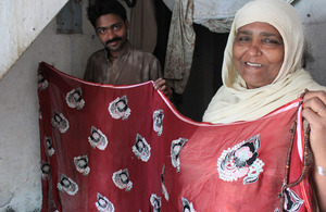 Sughra Baji proudly displays a product from her cloth embellishment business. Picture: Victoria Francis/ DFID
