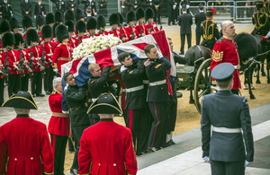 The bearer party, consisting of 10 tri-Service personnel, carries Lady Thatcher's coffin into St Paul's Cathedral [Picture: Sergeant Adrian Harlen, Crown copyright]