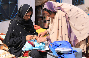 Tahira with a patient and her young child. Picture: Victoria Francis/ DFID