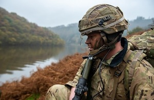 Soldier looking across a river