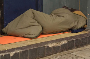 Man sleeping rough in a doorway