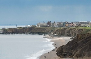View from the England Coast Path looking at Seaham from the north. A long beach and a small settlement is visible.