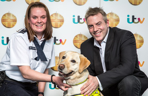Border Force top dog Tyke with handler Sam O'Connor and TV presenter Donal MacIntyre