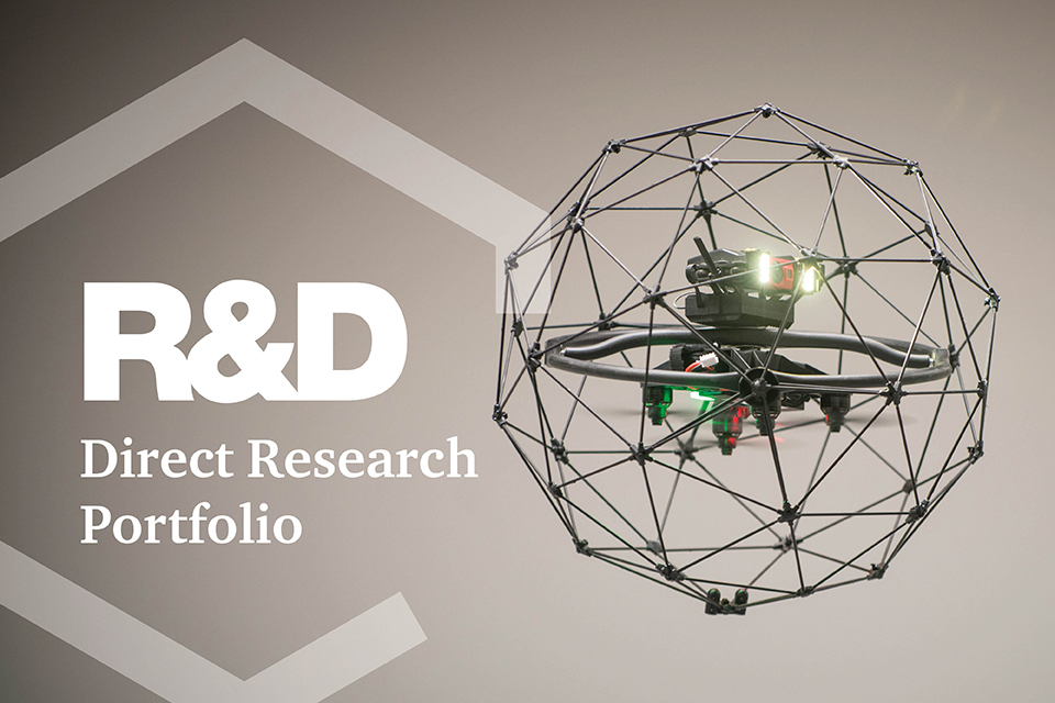 Airborne drone with R&D text superimposed over the images