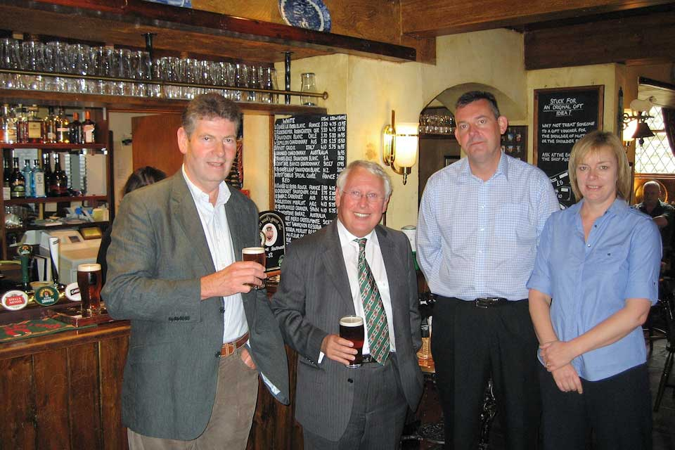Bob Neill with the licensees of Tthe pub