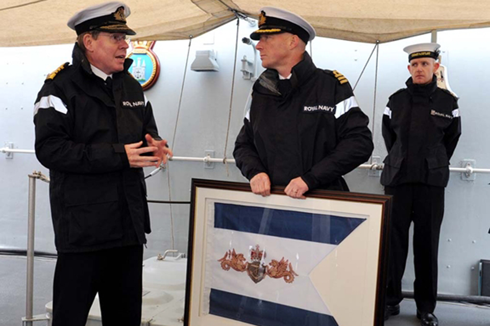Admiral Sir Mark Stanhope presents Commander Andy Lamb with the Surface Flotilla Efficiency Pennant
