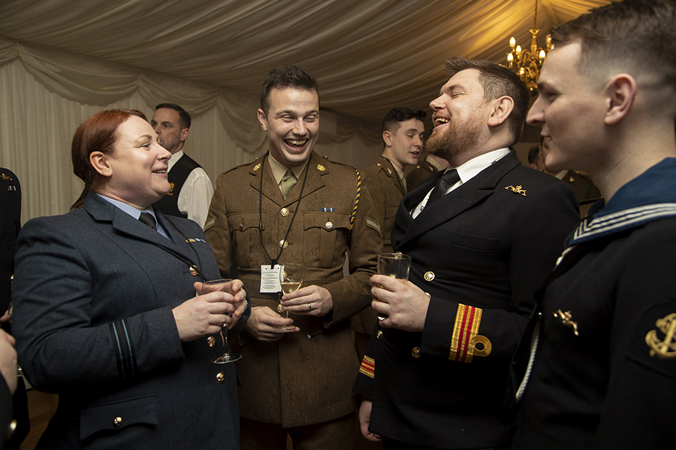 Members of the three Services enjoying the LGB20 reception in the House of Commons terrace.