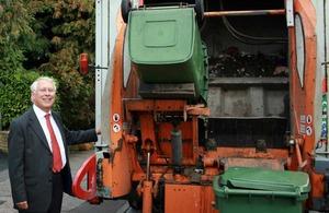 Bob Neill next to a rubbish van
