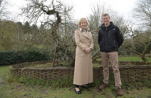 Tim Peake and Andrea Leadsom plant trees grown from apple seeds taken to space. Credit: National Trust