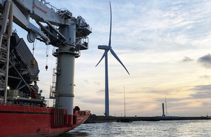 Image of the Port of Blyth wind power generator and ship coming in.