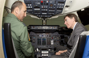 Wing Commander Jon Beck, Officer Commanding 32 (The Royal) Squadron, shows Philip Dunne, Minister for Defence Equipment, Support and Technology the cockpit of the new BAe 146 Mk3 aircraft [Picture: Senior Aircraftman Stewart Paterson, Crown copyright]