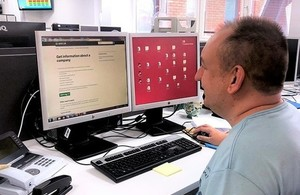 Employee from customer services team working on a computer.