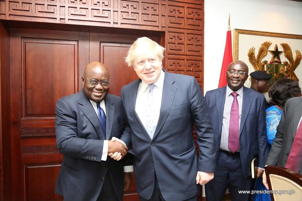 An image of H.E. Nana Akufo Addo, President of Ghana shaking hands with British PM Boris Johnson
